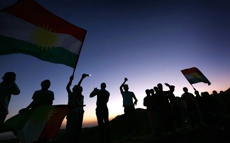 People wave the flag of Kurdistan on Monday to show support for the upcoming independence vote in Akre, Kurdistan Region. Photo: Safin Hamed | AFP
