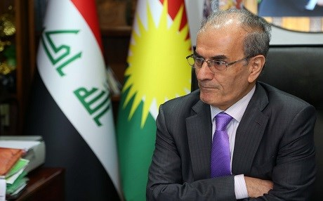 Kirkuk Governor Najmaldin Karim sits in his office in Kirkuk on September 14, 2017 as the Iraqi parliament voted to sack him on the same day. Karim says he does not abide by the law calling it