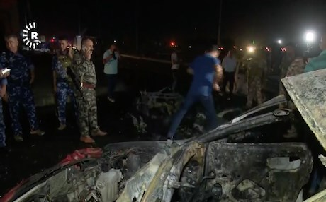 Policemen and civilians gathering at the site of the car bomb in Kirkuk. Photo: Rudaw video