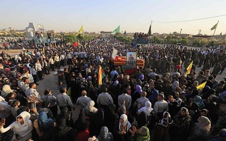 Mourners gather in Qamishli for the funeral of fighters from the Syrian Democratic Forces that were killed in combat against ISIS in Raqqa on September 13. Photo: Delil Souleiman | AFP