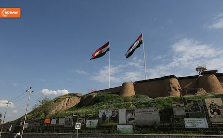 Kurdistan and Iraqi flags flying side-by-side over Kirkuk castle. Photo: Rudaw