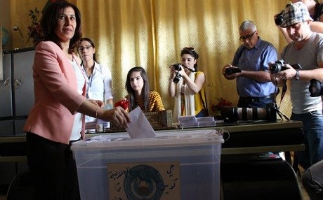Hadiya Yousif, co-chair of the founding council for the the Democratic Federal System of Northern Syria casts her vote for local elections on September 22, 2017. Photo: ANHA