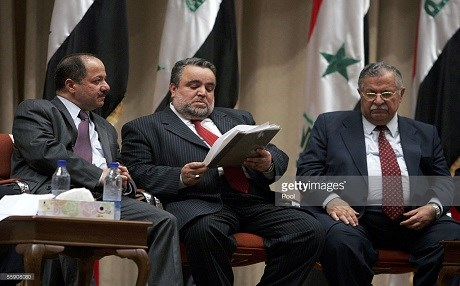 Masoud Barzani of the Kurdistan Democratic Party, Hajim al-Hassani, a Sunni politician of the Iraqi Islamic Party, and Jalal Talabani of the Patriotic Union of Kurdistan sit for a Transitional National Assembly meeting in Baghdad in October 12, 2005. Photo: Mohamed Mesara | AFP via Getty