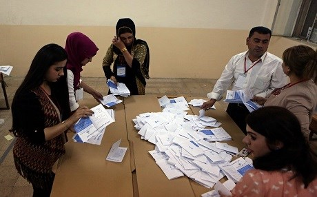 Referendum officials count ballots at a voting station in Erbil on Mondy. Photo: AP