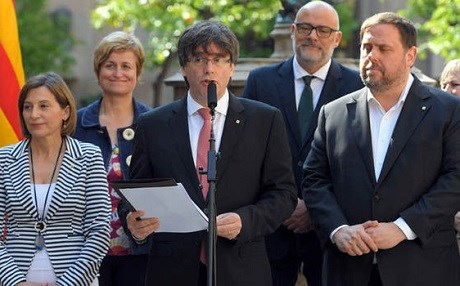 Catalan President Carles Puigdemont in June announcing the region's October 1 referendum. Photo: AFP