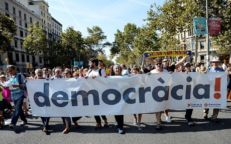 Pro-independence demonstrators in Catalonia march the streets of Barcelona on September 23. Photo: Josep Lago | AFP