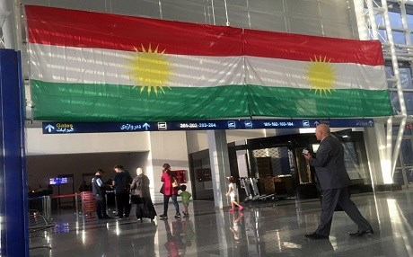 A Kurdish flag hangs in the Erbil International Airpor on Wednesday, Sept. 27, 2017. Iraq's prime minister ordered the country's Kurdish region to hand over control of its airports to federal authorities or face a flight ban, a response to the Kurdish independence referendum. Photo: AP/Khalid Mohammed