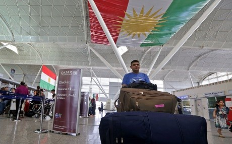 Passengers are seen at Erbil airport on September 28, 2017. All foreign flights to and from the Kurdistan Region will be suspended from Friday, officials said, as Baghdad increases pressure on the Kurds over this week's independence referendum. Photo: AFP/ Safin Hamed
