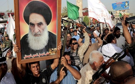 Grand Ayatollah Ali al-Sistani, whose portrait is being held aloft by his Shiite supporters, has called on the Kurdistan Region to go back to the