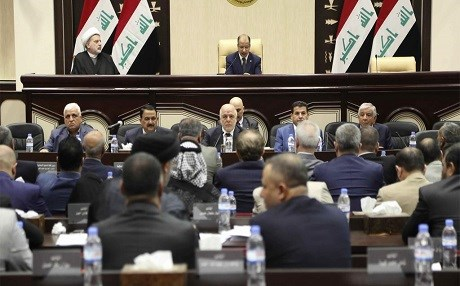 Iraqi Prime Minister Haider Al Abadi [centre]  attends a session of the Iraqi parliament in Baghdad on September 27, 2017 when they passed a set of measures against the Kurdish independence vote held by Erbil. Photo Karim Kadim / AP
