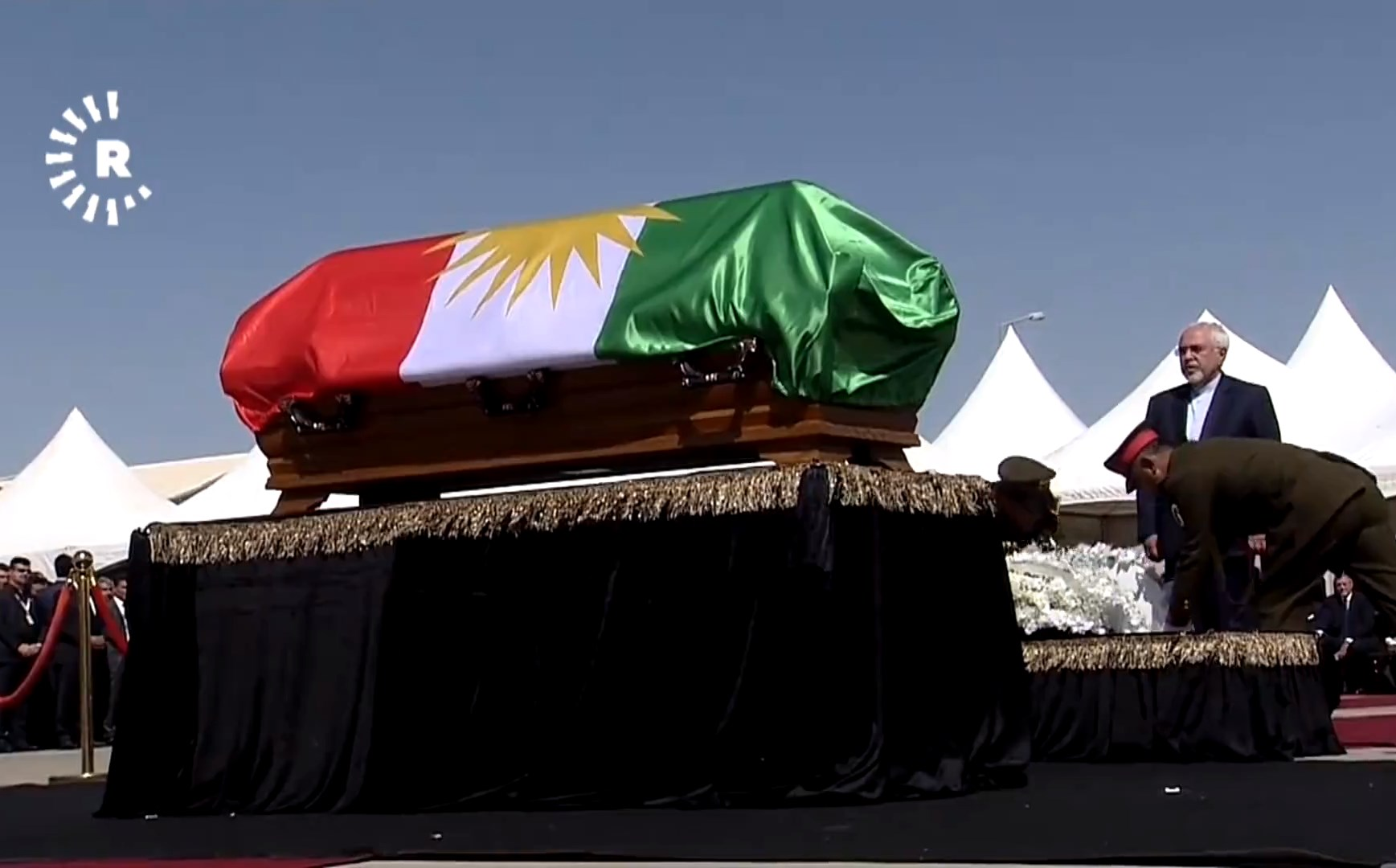 Iranian Foreign Minister Mohammad Javad Zarif laying a wreath at the coffin of Kurdish leader Jalal Talabani in Sulaimani on October 6. Photo: Rudaw TV