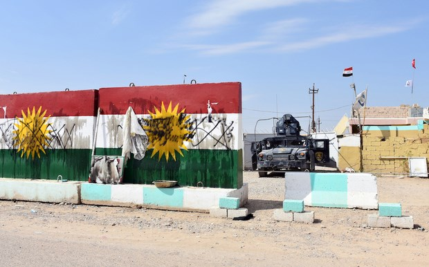 Defaced Kurdistan flags at a former Peshmerga position in Tuz Khurmatu now held by Iraqi forces on Friday. Photo: AFP