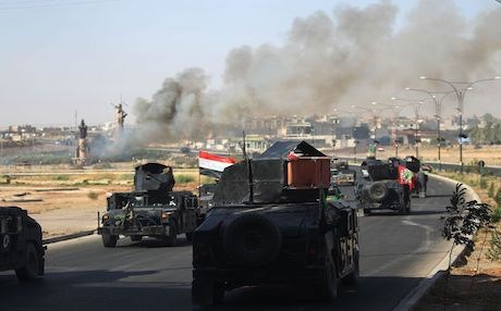 Iraqi armed forces including Iranian backed Shiite Hashd al-Shaabi advance toward the center of Kirkuk during an operation on October 16. Photo: AFP