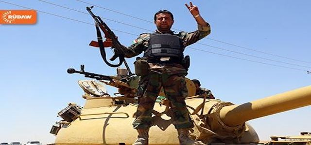 File photo of a Peshmerga soldier flashing victory sign on a tank in Rabia.