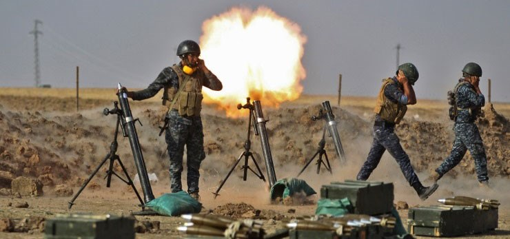 Iraqi forces fire mortars at Peshmerga positions near Fishabur on Thursday. Photo: Ahmad al-Rubaye/AFP