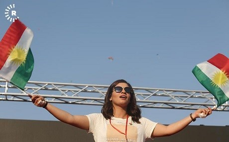 A woman waves the Kurdistan flag at a festival in Erbil in September. Photo: Sartip Othman/Rudaw