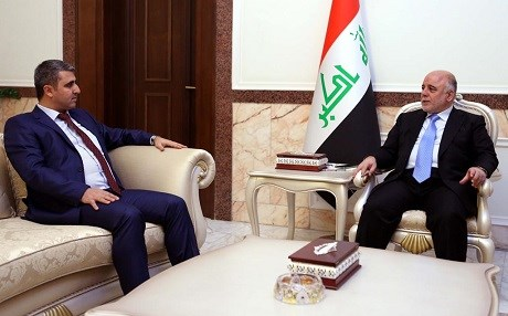 File photo shows Iraqi parliament deputy speaker Aram Sheikh Mohammed [L] meets with Iraqi Prime Minister Haider al-Abadi in May, 2015. Photo: Iraqi PMO