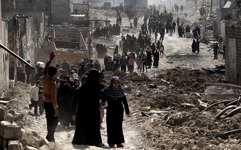 Civilians fleeing west Mosul during military operations to defeat ISIS in the city in March. Photo: AFP