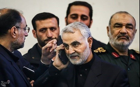 Qasem Soleimani [C], commander of the Iranian Quds Force, receives a phone call from the head of the Palestinian Hamas organization in November, 2017 to express condolences to the death of Soleiman's father. File photo: Tasnim News Agency