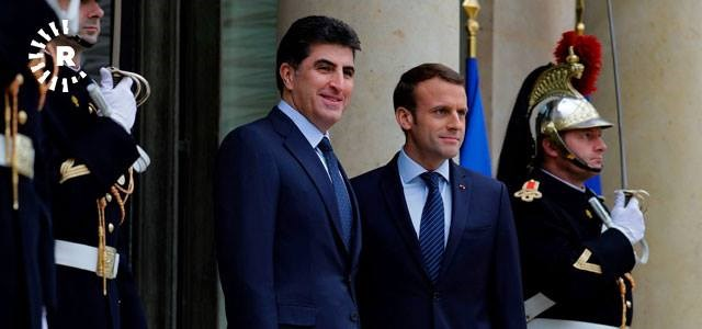French President Emmanuel Macron [R] welcomes the KRG Prime Minister Nechirvan Barzani [L] at Elysee Palace in Paris on December 2, 2017. Photo: AFP/Thomas Samson
