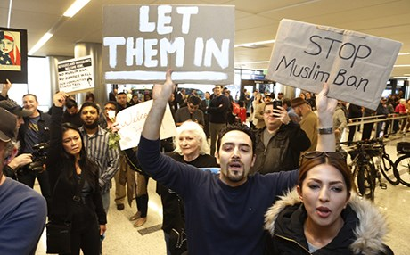 People demonstrate against Trump's executive order making it more difficult for millions from Muslim-majority countries to enter the United States in Los Angeles on February 2, 2017. Photo: Damian Dovarganes | AP
