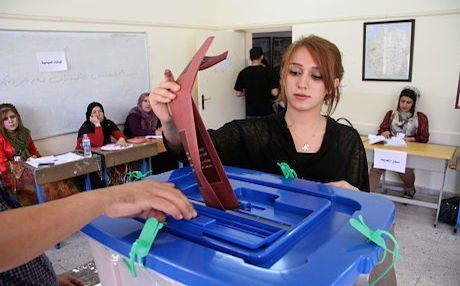 A woman casts her vote during the elections in September 2014. Photo: Rudaw