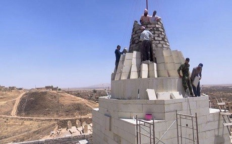 Yezidi volunteers rebuilding a temple in Bashiqa in June. Photo: Rudaw TV