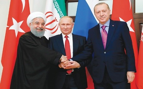 President of Iran Hassan Rouhani (L), Russian President Vladimir Putin (C) and Turkish President Recep Tayyip Erdogan shake hands at the start of talks on the future of Syria in November, 2017. Photo:AP