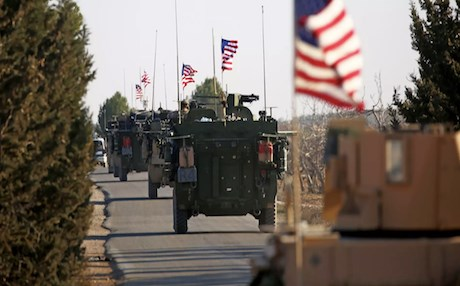 A US convoy drives through northern Syria in support of anti-ISIS operations. Photo: Delil Souliman | AFP
