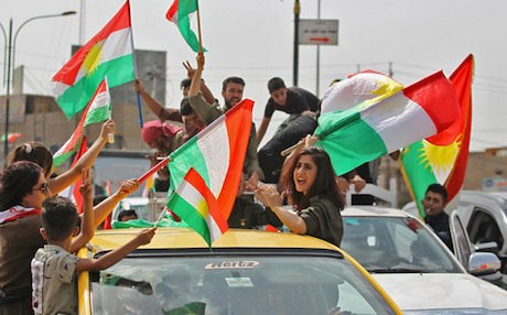 People in Kirkuk wave the Kurdistan flag in the streets September 25, 2017, the day an independence referendum was held in the Kurdistan Region including in the disputed city. Photo: AFP/Ahmad al-Rubaye