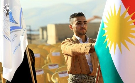 Kurdish student raises the flag of Kurdistan in a graduation ceremony in November 2017 in Sulaimnai, Kurdistan Region. File photo: Rudaw/Sartip Othman