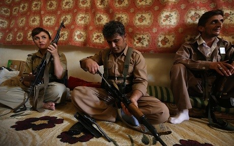 KDPI fighters maintain their rifles as part of a military exercise near Koye, Kurdistan Region, on August 23, 2017. Photo: Safin Hamed | AFP