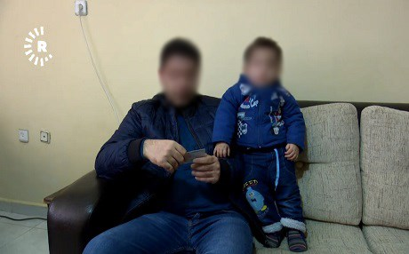 A Kurdish refugee in Turkey and his son speak to Rudaw in Amed or Diyarbakir. Photo: Rudaw TV
