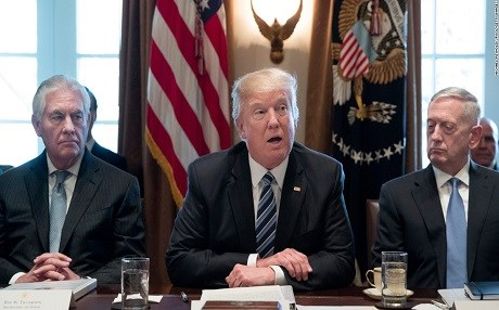 US President Donald Trump is flanked by Secretaries of State and Defense Rex Tillerson (left) and James Mattis, respectively. Photo: Michael Reynolds | AFP
