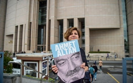 A protester holds a poster of Mehmet Altan outside a Turkish court in  2017. Altan, 64, has written books on Turkish politics. His brother Ahmet, a novelist and journalist for some of Turkey's leading dailies, is also being held in the same case, but has not had a ruling yet. File photo: AFP