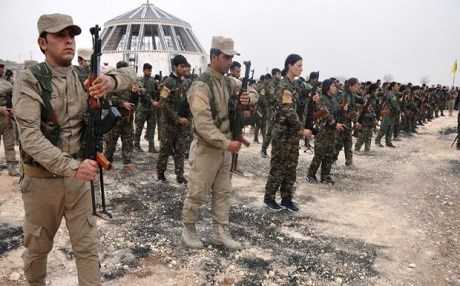 YPG and YPJ fighters carry out a military ceremony in Kobane. Photo: PYD