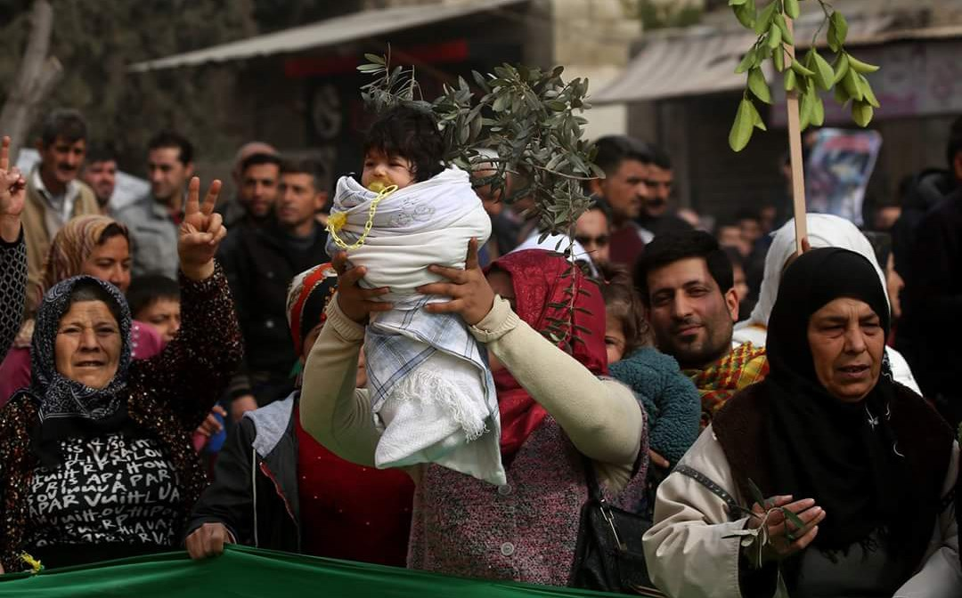 Citizens of Afrin protest Turkey's military operation on Sunday. Photo: Delil Souleiman/AFP