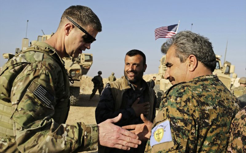 US Army Maj. Gen. Jamie Jarrard shakes hands with commander of the Manbij Military Council Muhammed Abu Adeel last week. Photo: Susannah George/AP