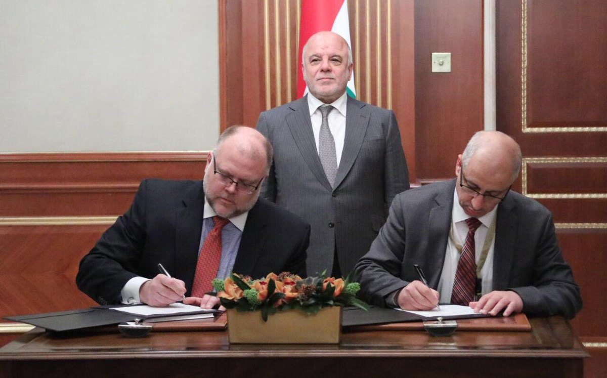 Haider al-Abadi overseeing the signing of a Memorandum of Understanding between Iraq and the Export-Import Bank of the United States extending a $3 billion line of credit in Kuwait on Tuesday. Photo: Iraqi PM office