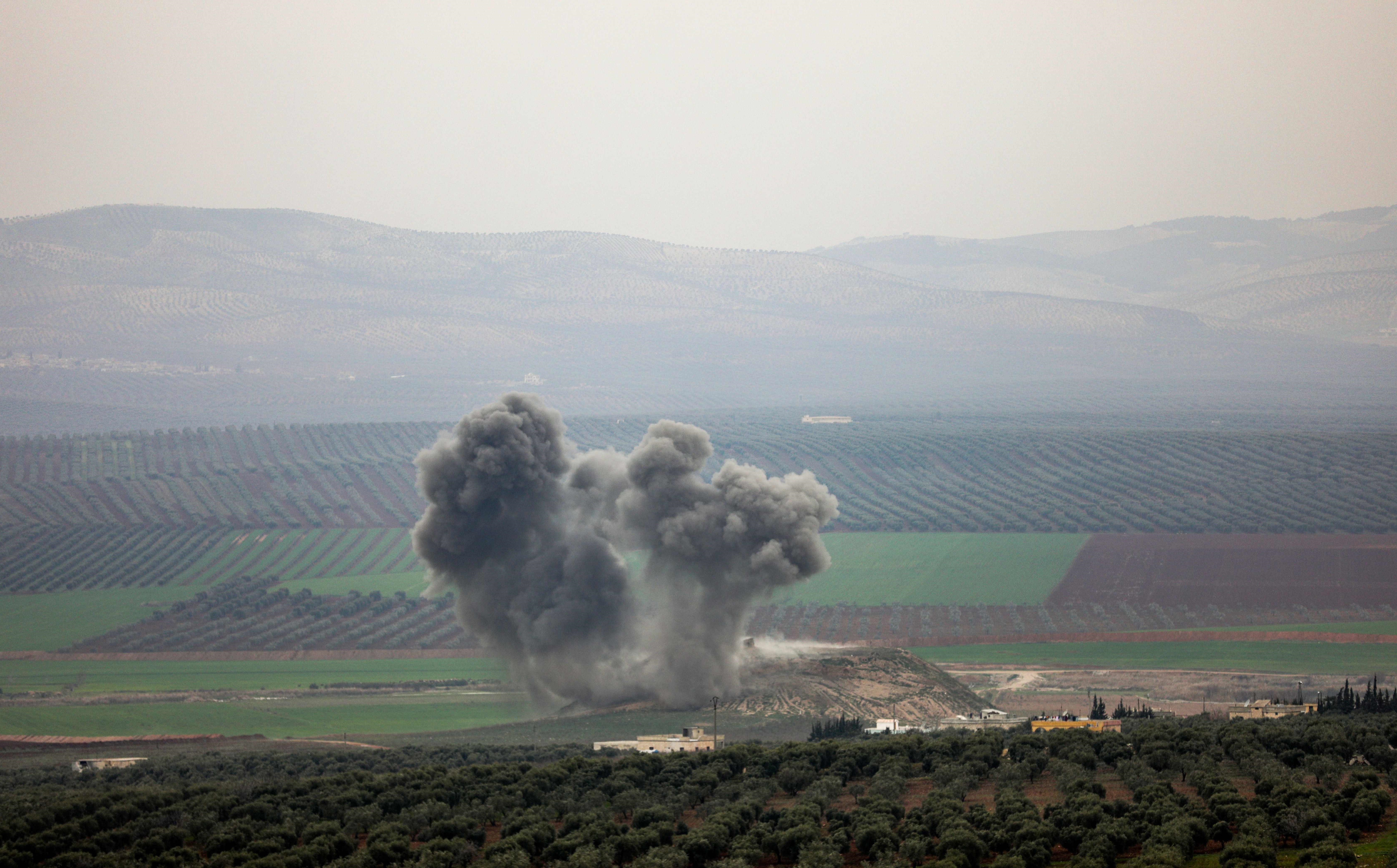 Smoke rises over the southern Afrin village of Deir Ballut after Turkish airstrikes on Saturday. Photo: Omar Haj Kadour/AFP