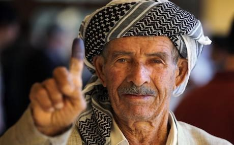 An Iraqi Kurdish man shows his ink-stained finger after voting during the Kurdistan's legislative election at a polling station on 21 September 2013 in the northern Kurdish city of Arbil. Photo: AFP/Ahmad al-Rubaye