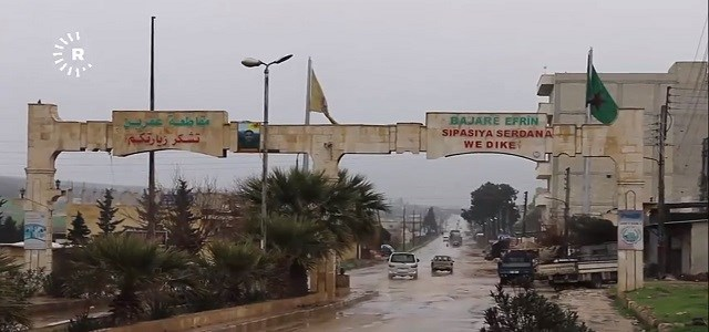 A sign reads 'Welcome to the city of Afrin' in Kurdish and Arabic, in northwestern Syria's Aleppo province on February 19, 2018.