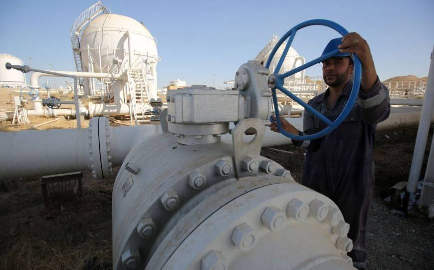 A worker checks pipelines at Kirkuk's Bai Hassan oil field after control of the site was taken by Iraqi forces in October. File photo: AFP