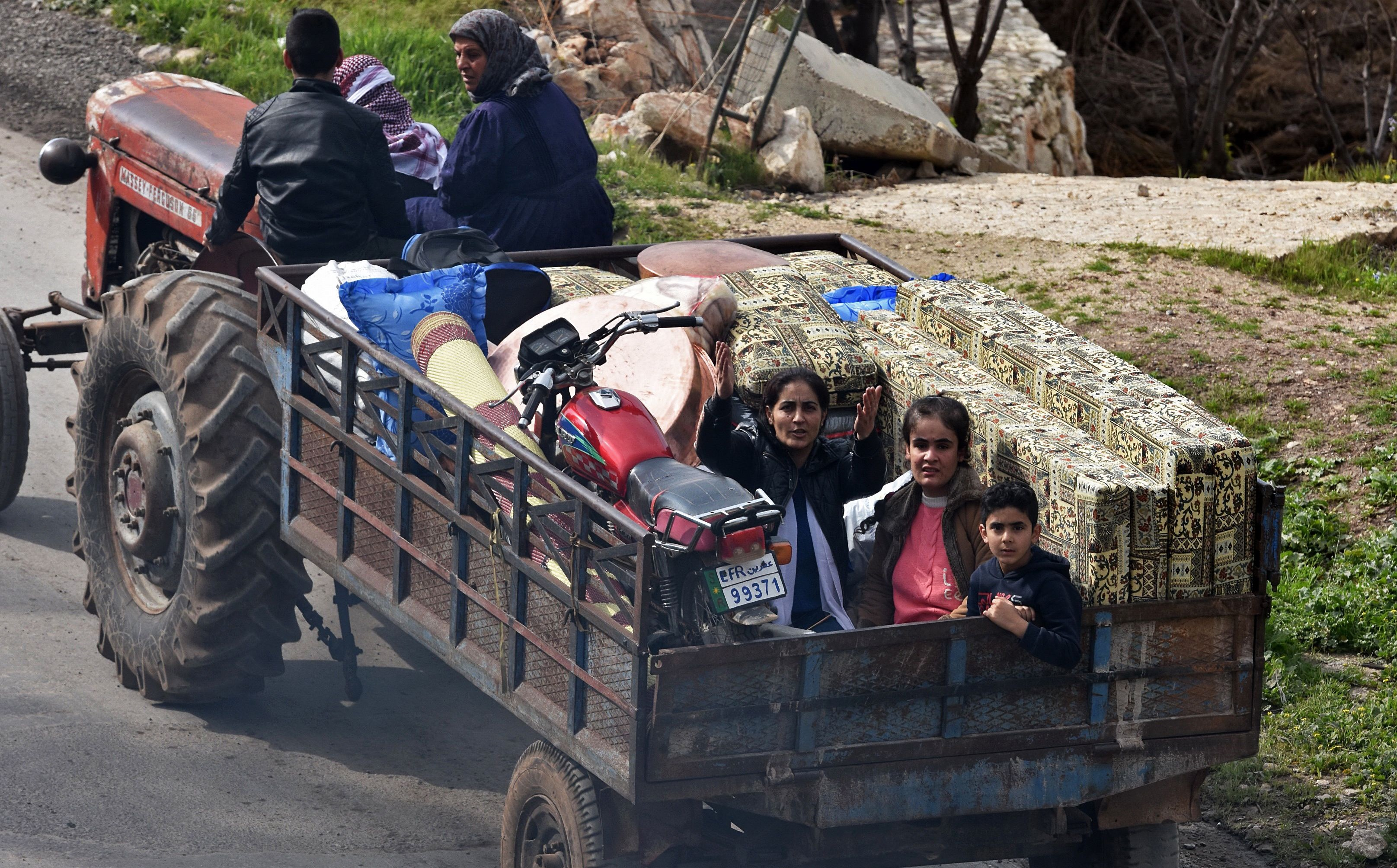 Kurds flee the city of Afrin this week as Turkish forces and Syrian militias approach. Photo: George Ourfalian/AFP