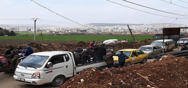 In Kurdish Afrin's countrysides, people are fleeing as Turkey and its FSA proxy fighters press towards the capital city. Photo: AFP/George Ourfalian/File