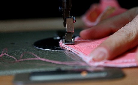 A tailor sews traditional Kurdish clothing. File photo: Rudaw