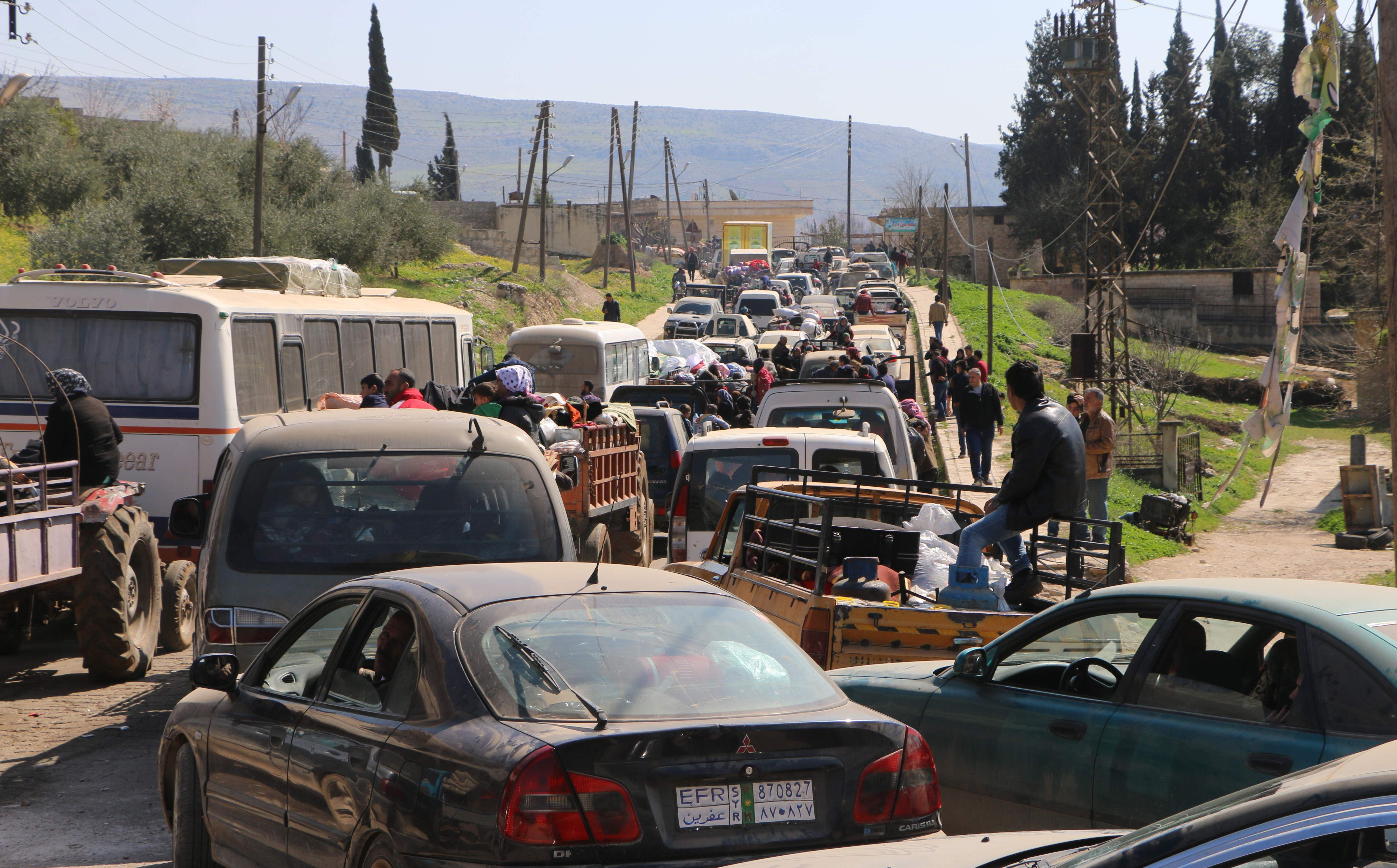 Civilians drive through Ain Dara as they flee Afrin on Monday. Photo: AFP