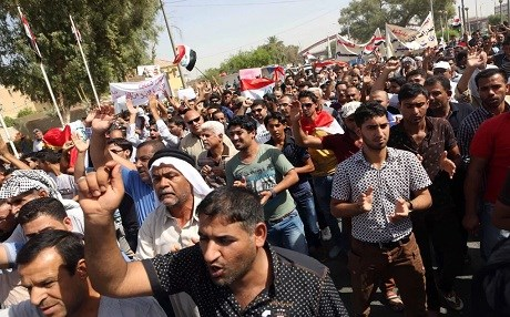 In this file photo from 2015, Basra residents chant for the creation of an autonomous region. Photo: AP