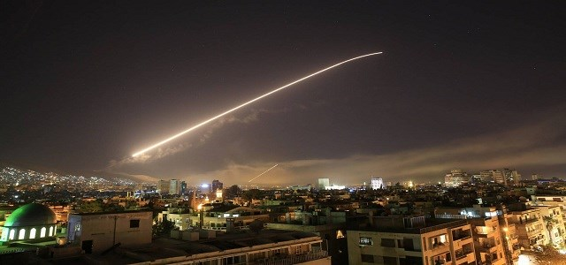 The Damascus sky lights up with surface-to-air missile fire as the US and allies target different parts of the capital early on April 14, 2018. Photo: Hassan Ammar | AP