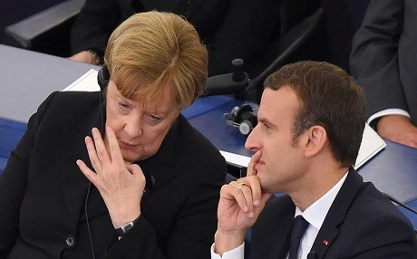 German Chancellor Angela Merkel and Emmanuel Macron chat in Strasbourg, France, in July 2017. Photo: EU